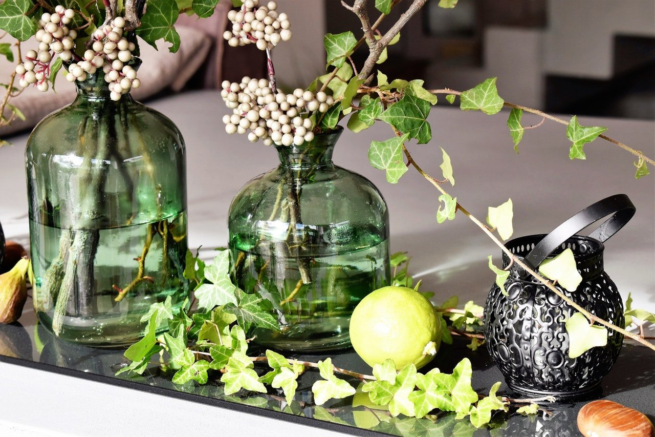 green-leaved-plants-in-green-clear-glass-vase-209481