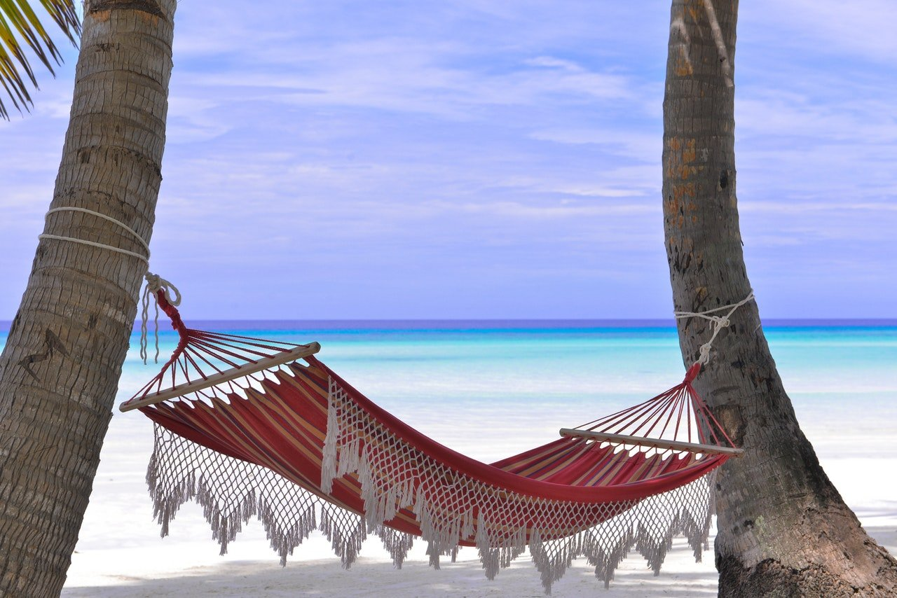 red-hammock-tied-between-two-trees-1450372